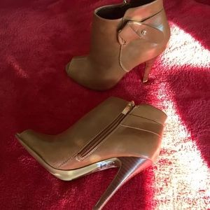 A pair of leather Guess shoes